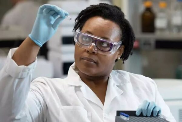 Scientist in a Lab Coat looking at Laboratory samples